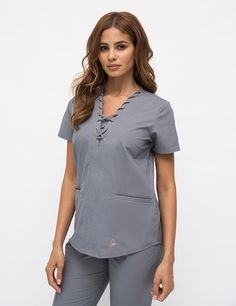 The Lace-Up Top in Graphite - Medical Scrubs by Jaanuu Scrubs Outfit, Scrubs Uniform, Jaanuu Scrubs, Cute Scrubs, Medical Scrubs, Nursing Scrubs, Womens Scrubs, Nursing Clothes, Costume