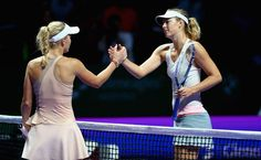 Maria Sharapova Photos: BNP Paribas WTA Finals: Day 2. Caroline Wozniacki of Denmark shakes hands at the net after her three set victory against Maria Sharapova of Russia in their round robin match during the BNP Paribas WTA Finals at Singapore Sports Hub on October 21, 2014 in Singapore.