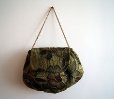 Iridescent green purse with floral texture by knittingcate on Etsy, $48.00