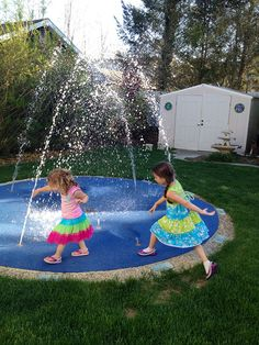 This residential splash pad has the added safety of Polysoft Safety Surface.  Mom can sit and read a book while the kids play. SAFE, fun and colorful water play in your backyard splash park.