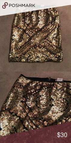 Sequined mini skirt Shades of gold and copper mini skirt with back zipper. Lily White Skirts Mini