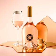 A bottle of pink Miraval rosé with a glass of wine