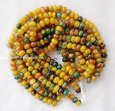 http://www.gets.cn/product/Rainbow-Agate-Beads--yellow-green--Rondelle--14x14x9mm_p197816.html