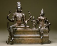 Somaskandamurti is one of the most popular religious images in South India. The four-armed Shiva holds a battle-ax and a deer in his upper hands and a citron in his lower left hand. His lower right hand is raised in abhayamudra (the gesture that allays fear)