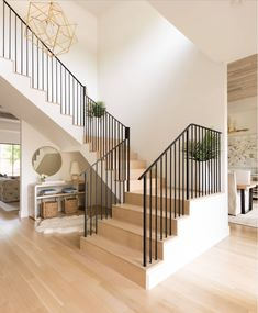 "A photo gallery of 101 amazing staircase design ideas plus our ""types of stairs"" chart that explains the parts of a staircase and types of staircases. Entryway Stairs, Staircase Railings, Modern Staircase, Staircases, Staircase With Landing, Craftsman Staircase, Banisters, Railing Design, Staircase Design"