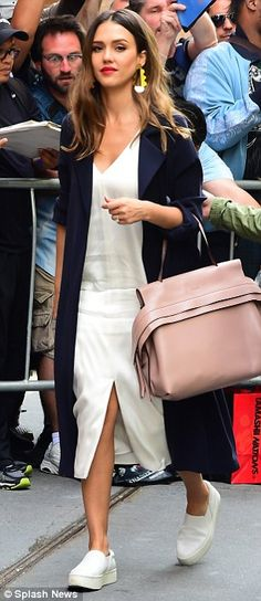 Cute, but casual: The busy mom-of-two paired the elegant outfit with slip-on white tennis shoes, giving it a more casual look