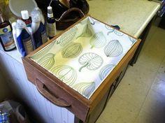 Easy tutorial on how to line drawers with fabric using cardboard and hot glue.