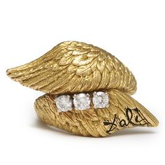 "Salvador Dali Gold Angel Wings Ring Gold angel wings ring set with three diamonds, signed ""Dali"" in black enamel. Designed by S. Dali, American, ca. 1950 Available at A La Vieille Russie"