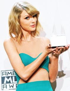 Taylor Swift with her Dick Clark award of excellence.