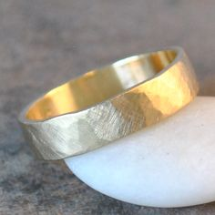 A gorgeous organic men's handmade wedding band, in recycled 14k yellow gold. Other metals and styles available. Perfect for your sexy man.