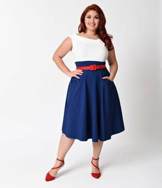 Were screaming for Tippi, gals! Presenting a thrilling plus size swing dress, from Unique Vintage, in a bold navy blue and white colorblock with a bright red belt for a dash of vintage verve. Made in a soft stretch fabric, Tippi is a fabulous flare featu