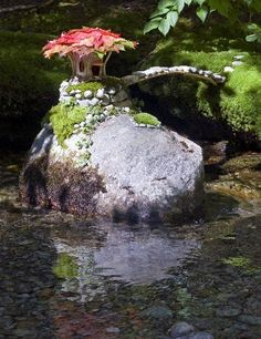 Clever idea for a home pond or stream: Fairy house on rock island. {image only}