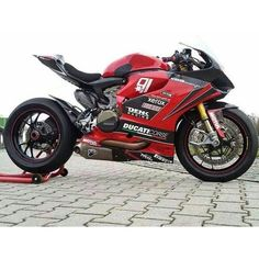 Denk Racing 1199. Many Ducati stores also race and or produce their own parts. http://ducati.denk-gmbh.de/index.php/home/denk-news/12-news/8-triple-sieg-fuer-kymco