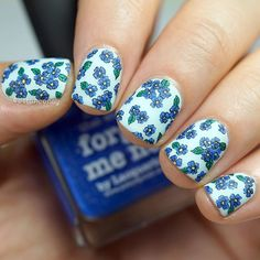 WEBSTA @ cottonconey - Found a flower I've never painted before: forget-me-not Base is @picturepolish 'sky'. I handpainted the lines with black acrylic paint and filled the…