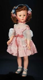 "Life Size Sweet Sue Walker in Rose Taffeta Dress by American Character-  circa 1955 - 31"" Vinyl socket head, rigid vinyl body with jointing at shoulders and knees, blue sleep eyes, brush lashes, closed mouth with red lips, blushing complexion, and rooted tosca saran curly hair- a pale pink taffeta dress with blue floral puff sleeves, lace trim, coral waist ribbon, blue headpiece with multi-colored floral accents, white ankle socks, blue peep-toe Mary Jane shoes Z"