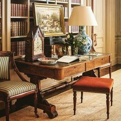 Richly layered vignette with antiques, books, art - Gil Schafer