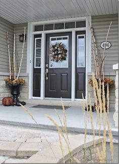 Birch filled urns and glam fall wreath Setting for Four