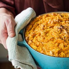 Sweet Potato Spoon Bread: This soufflé-like side dish from Sara Foster is an irresistible combination of sweet potatoes, cornmeal, eggs, and brown sugar. Sweet Potato Casserole, Casserole Dishes, Casserole Recipes, Thanksgiving Recipes, Holiday Recipes, Holiday Meals, Sara Foster, Spoon Bread, Biscuits