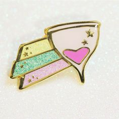 Gold tone metal with light pink menstrual cup & pink heart flow. Cup Comet with pastel yellow, teal, & pink glitter with raised star accents. One posts with gold tone metal clutch back. Badge, Menstrual Cup, Pastel Yellow, Pin And Patches, Shooting Stars, Pink Glitter, Lapel Pins, Halloween, Teal
