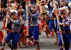 Young filipino Davaoeño Warriors - The Kadayawan Festival is usually marked with colorful parades as Davaoeños dress in intricately-designed native costumes - Davao, Philippines.