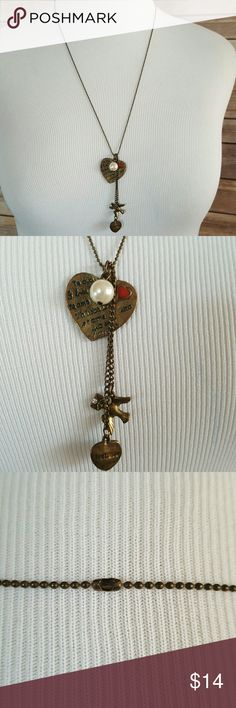 'I love you' Necklace with Heart Pearl Dove Charms Purely fashion jewelry Has a large heart with 'I love you' in different languages unknown Jewelry Necklaces