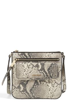 This glam snake-print leather crossbody bag is equally well-suited for travel around town and adventures overseas.