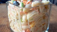 This is, by far, the best macaroni salad I've ever put into my mouth. It has a perfect blend of sweetness and tartness, and it is so pretty with all of the multi-colored veggies. Be ready for this to disappear before you put it on the table! I have six children, and it is all I can do to keep them from nibbling on it while I'm mixing it up!