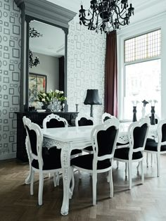 I love the black and white table/ chair combo.  This is a great piece of inspiration for my dining room.  Grant it, mine won't come off looking quite so stunning but I can dream.