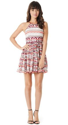 Warm, natural hues highlight the bold Aztec print in this chic halter dress for a statement, warm weather look. Accordion pleats accent the miniskirt...