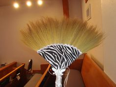Jumping the broom is an African Tradition where the bride and groom jump it as soon as they are pronounced husband & wife. The broom is decorated with fabric, trim, doves and silver ribbon wrapped around the stick.