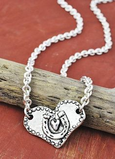 """Cowgirl at Heart Necklace  Anchoring a thick silver chain is an elegant heart with a horseshoe etched into its front, the back reads """"cowgirl at heart"""". 18""""   #necklaces #hearts #horseshoes #jewelry #handmadejewelry #heartnecklaces #inspirational  www.islandcowgirl.com"""