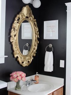 With a scrolly gold mirror, textured globe lights and pink accents, Bethany at Dwellings by Devore created a truly glam bathroom. But black walls offer drama and warmth to what could be a chilly space. See more at Dwellings by Devore Black Rooms, Black Walls, Navy Walls, Bathroom Inspiration, Interior Inspiration, Gold Bad, Home Interior, Interior Design, Bathroom Interior