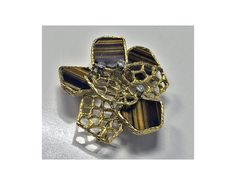 View this item and discover similar for sale at - English Diamond and tigers eye Pendant brooch, Hallmark The brooch of abstract design alternating flat tigers eye and open bark florentine Vintage Brooches, Gold Pendant, Mid Century, English, Organic, Jewellery, Eyes, Diamond, Unique