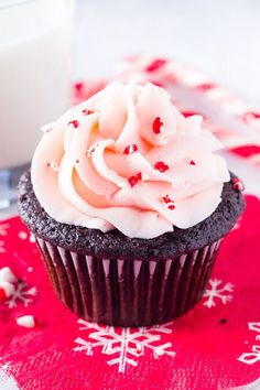 Candy Cane Chocolate Cupcakes. Super moist chocolate cupcake topped with peppermint buttercream and sprinkled with candy canes - the perfect holiday cupcake! www.justsotasty.com