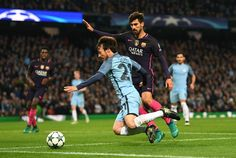 David Silva of Manchester City (L) is fouled by Andre Gomes of Barcelona (R) during the UEFA Champions League Group C match between Manchester City FC and FC Barcelona at Etihad Stadium on November 1, 2016 in Manchester, England.