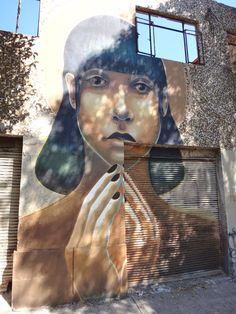 by Fusca - Black hair girl on the wall