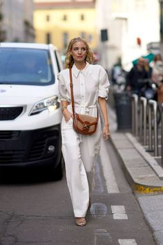 Go bright white with a one-piece jumpsuit that's the perfect spring outfit all wrapped into one. Try a sandal and saddle bag by day, and add an earring and a red lip for nighttime.