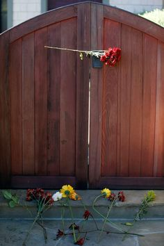 Flowers left at the gate of Paul's home.