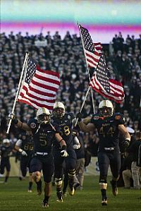 LANDOVER, Md. (Dec. 10, 2011) U.S. Navy Midshipmen charge the field to kick-off the 112th Army-Navy college football game at FedEx Field. This is the first Army-Navy game played in our Nation's Capital. (U.S. Navy photo by Mass Communication Specialist 2nd Class Kori Melvin)
