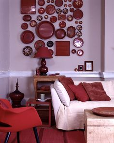 Dark Red  An assortment of lacquered plates and trays creates a bold display in a living room. To color it red, lacquer is tinted with cinnabar or vermilion. Lacquer can also be dyed black, green, yellow, gold, or brown by adding various pigments, as in the lacquered eighteenth-century Chinese side table.