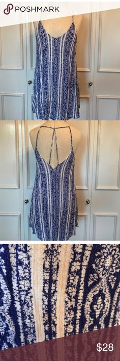 """Free People blue tribal print strappy caged dress Excellent used condition hi low hem dress with criss cross strappy back. Dark navy blue and white ethnic boho print. 29.5"""" at the shortest point and 34"""" at the longest in the back. Bust is 35"""" Free People Dresses Mini"""