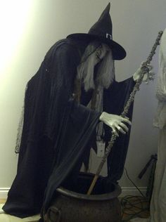 "Stirring witch - pvc frame, foam body.  There's a mechanism in the caouldron that makes her ""stir"""