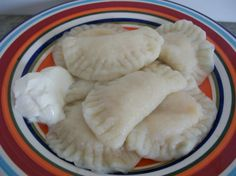 **Pyrizhky (Perogies)** A Ukrainian dish made with potatoes and cheese inside dough. Often served with cream cheese, bacon or oinions.