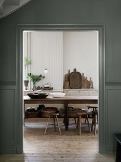 This beautiful Villa in Gothenburg, Sweden has such a cozy feel to it … the warm wood furniture and wood flooring, olive green walls (pigeon by farrow & ball + shaded white) and simple styling, with a