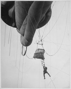 """Returning from a U-Boat scouting party. Aerial naval observer coming down from a """"Blimp"""" type balloon after a scouting tour somewhere on the Atlantic Coast. Central News Photo Service. Vive Le Sport, Still Picture, Navy Man, National Archives, World War One, Wwi, Balloons, Air Balloon, Coast"""