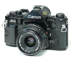 Canon A-1. Theirs nothing like the click of the camera. The noise is simply amazing!