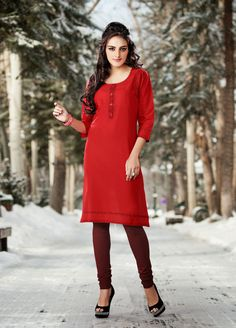 Red color pure cotton Fabric Kurti. This Kurti is beautified with contrast decorative printed motifs at neck line & below. Contrast placket patch with fancy fabric buttons decked completes the look.