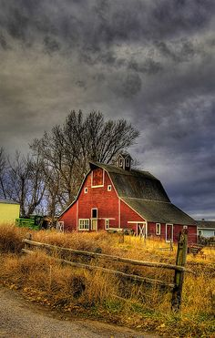 Gorgeous red barn under stormy skies #farms #mindymcpherson #realtor #realestate #mission