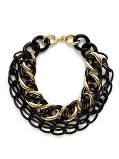 Kenneth Jay Lane Black & Gold Multi-Strand Link Necklace. Perfect to add to a simple T-Shirt or dress up a Sexy black dress. Add Gold bangles and a gold Statement ring.  Check out more Styling Tips at  Heatherraemitchell.com