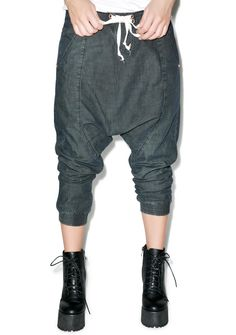 One Teaspoon Luxe Harem Pants are made to make yer stems look stellar! Hit the next level of high fashion with these gorge harem pants. Made of a soft n' light denim, these bbs feature an exxtra low drop crotch with a tapered fit, belt loops, drawstring closure with hook and eye clasp inside. Two front and back pockets stash all yer stuff, and they're cut above the ankle with elastic leg openings to show a lil extra skin. Yer gonna get so many looks when ya hit the town in these bbs, yer…